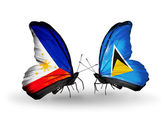 Two butterflies with flags on wings as symbol of relations Philippines and Saint Lucia — Stock Photo