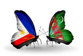 Two butterflies with flags on wings as symbol of relations Philippines and Turkmenistan — Stock Photo