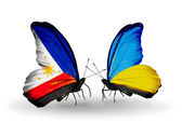 Two butterflies with flags on wings as symbol of relations Philippines and Ukraine — Stock Photo