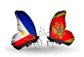 Two butterflies with flags on wings as symbol of relations Philippines and Montenegro — Stock Photo