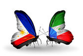 Two butterflies with flags on wings as symbol of relations Philippines and Equatorial Guinea — Stock Photo