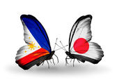 Two butterflies with flags on wings as symbol of relations Philippines and Japan — Stock Photo