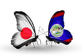 Two butterflies with flags on wings as symbol of relations Japan and Belize — Stock fotografie
