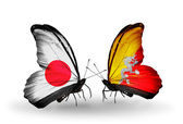 Two butterflies with flags on wings as symbol of relations Japan and Bhutan — Stock Photo