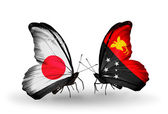 Two butterflies with flags on wings as symbol of relations Japan and Papua New Guinea — Стоковое фото