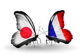 Two butterflies with flags on wings as symbol of relations Japan and France — Stock Photo