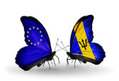 Two butterflies with flags on wings as symbol of relations EU and Barbados — Stock Photo