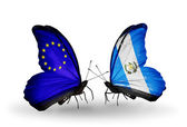 Two butterflies with flags on wings as symbol of relations EU and Guatemala — Stock Photo