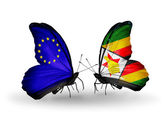 Two butterflies with flags on wings as symbol of relations EU and Zimbabwe — Stock Photo