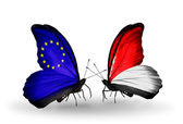 Two butterflies with flags on wings as symbol of relations EU and Monaco, Indonesia — Stock Photo