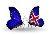 Две бабочки с флагами на крылья, как символ отношений Ес и Исландия — Стоковое фото