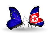 Iki kelebek kanatları ilişkiler ab ve kuzey kore sembolü olarak bayrakları ile — Stok fotoğraf