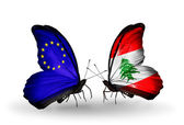 Two butterflies with flags on wings as symbol of relations EU and Lebanon — Стоковое фото