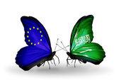 Dos mariposas con banderas en las alas como símbolo de las relaciones unión europea y arabia saudita — Foto de Stock