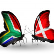 Stock Photo: Two butterflies with flags on wings as symbol of relations South Africand Denmark