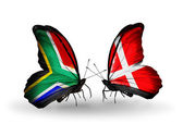 Two butterflies with flags on wings as symbol of relations South Africa and Denmark — Stock Photo