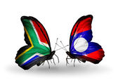 Two butterflies with flags on wings as symbol of relations South Africa and Laos — Stock Photo