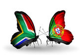 Two butterflies with flags on wings as symbol of relations South Africa and Portugal — Stock Photo