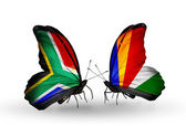 Two butterflies with flags on wings as symbol of relations South Africa and Seychelles — Stock Photo