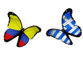 Concept - two butterflies with Columbia and Greece flags flying, like two football teams playing — Stock Photo