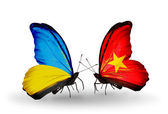Two butterflies with flags on wings as symbol of relations Ukraine and Vietnam — Foto Stock