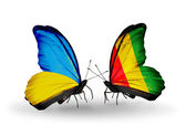 Two butterflies with flags on wings as symbol of relations Ukraine and Guinea — Stock Photo