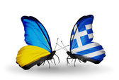 Two butterflies with flags on wings as symbol of relations Ukraine and Greece — Stock Photo