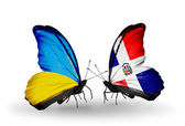 Two butterflies with flags on wings as symbol of relations Ukraine and Dominicana — Stock Photo