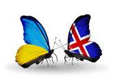 Två fjärilar med flaggor på vingarna som symbol för förbindelserna mellan ukraina och island — Stockfoto