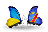 Two butterflies with flags on wings as symbol of relations Ukraine and Kongo — Stock Photo