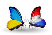 Two butterflies with flags on wings as symbol of relations Ukraine and Luxembourg — Stock Photo