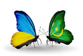 Two butterflies with flags on wings as symbol of relations Ukraine and Mauritania — Foto Stock