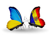 Two butterflies with flags on wings as symbol of relations Ukraine and Moldova — Stock Photo