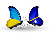 Two butterflies with flags on wings as symbol of relations Ukraine and Nauru — Stock Photo