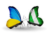 Two butterflies with flags on wings as symbol of relations Ukraine and Nigeria — Stock Photo