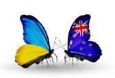 Two butterflies with flags on wings as symbol of relations Ukraine and New Zealand — Stock Photo