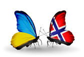 Two butterflies with flags on wings as symbol of relations Ukraine and Norway — Stock Photo