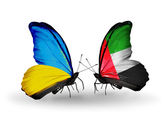 Two butterflies with flags on wings as symbol of relations Ukraine and UAE — Stock Photo