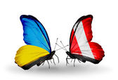 Two butterflies with flags on wings as symbol of relations Ukraine and Peru — Stock Photo