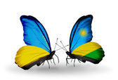 Two butterflies with flags on wings as symbol of relations Ukraine and Rwanda — Stock Photo