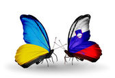 Two butterflies with flags on wings as symbol of relations Ukraine and Slovenia — Stock Photo