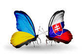 Two butterflies with flags on wings as symbol of relations Ukraine and Slovakia — Stock Photo