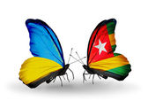 Two butterflies with flags on wings as symbol of relations Ukraine and Togo — Stock Photo