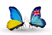 Two butterflies with flags on wings as symbol of relations Ukraine and Tuvalu — Stock Photo
