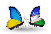 Two butterflies with flags on wings as symbol of relations Ukraine and Uzbekistan — Stock Photo