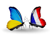 Two butterflies with flags on wings as symbol of relations Ukraine and France — Stock Photo