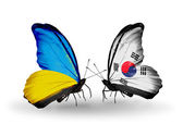 Two butterflies with flags on wings as symbol of relations Ukraine and South Korea — Stock Photo