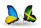 Two butterflies with flags on wings as symbol of relations Ukraine and Jamaica — Stock Photo