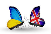 Two butterflies with flags on wings as symbol of relations Ukraine and UK — Foto Stock
