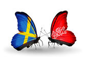 Two butterflies with flags on wings as symbol of relations Sweden and Waziristan — Stock Photo